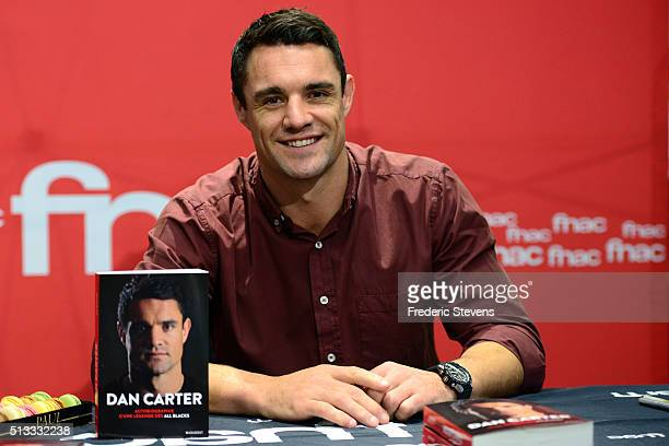 "New Zealand flyhalf Dan Carter poses during the book signing of his book ""Dan Carter: The Autobiography of an All Blacks Legend"" at the French retail..."
