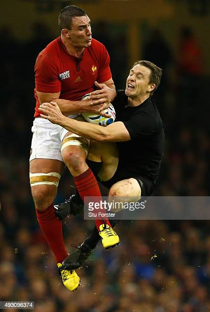 New Zealand full back Ben Smith goes for a high ball with Louis Picamoles during the 2015 Rugby World Cup Quarter Final match between New Zealand and...