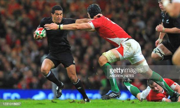 New Zealand full back Mils Muliaina hands-off Wales lock Luke Charteris during the International rugby union match between Wales and New Zealand at...