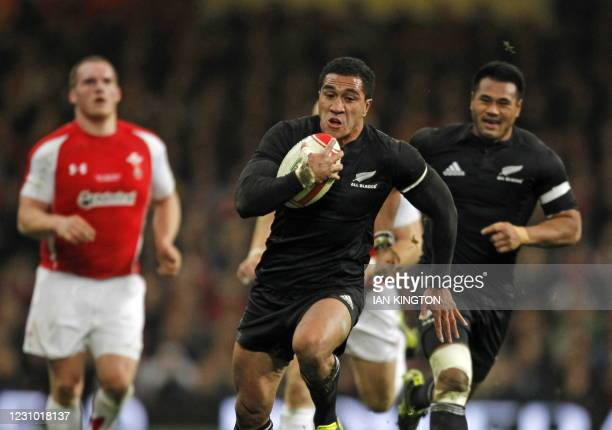 New Zealand full back Mils Muliaina runs in to score a try during the Autumn International rugby union match between Wales and New Zealand at The...