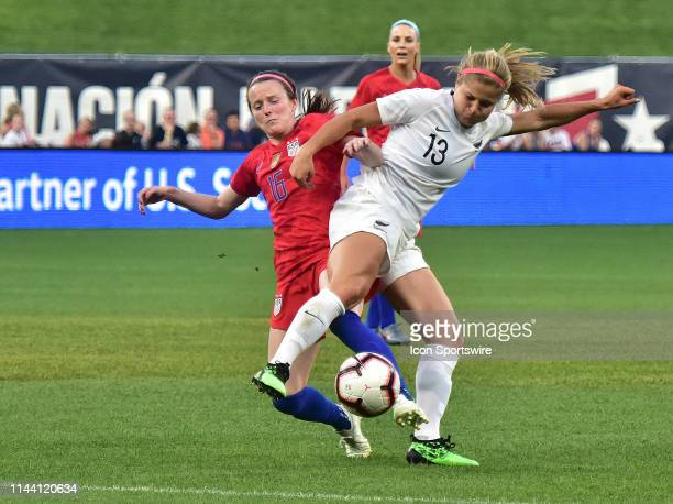 New Zealand fullback Rosie White and USA midfielder Rose Lavelle get their feet tangled while going after the ball during a soccer game between the...
