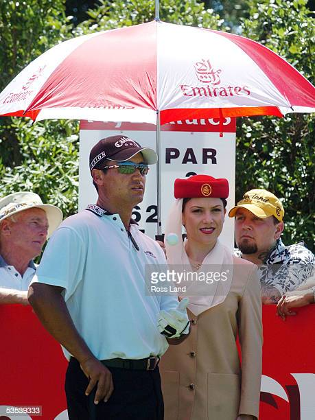 New Zealand golfer Michael Campbell seeks the shade of an Emirates umbrella on day one of the New Zealand golf open at Gulf Harbour Country Club,...