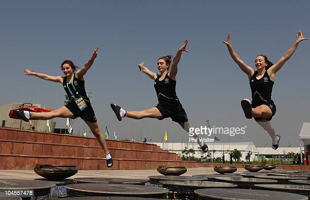 New Zealand gymnasts Holly Moon, Jordan Rae and Briana Mitchell pose for a photo in the International Zone at the Athletes Village ahead of the Delhi...