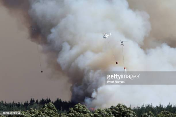 New Zealand Helicopters work on the fire as firefighters battle a blaze as 170 homes have been evacuated from the area in the Tasman district...