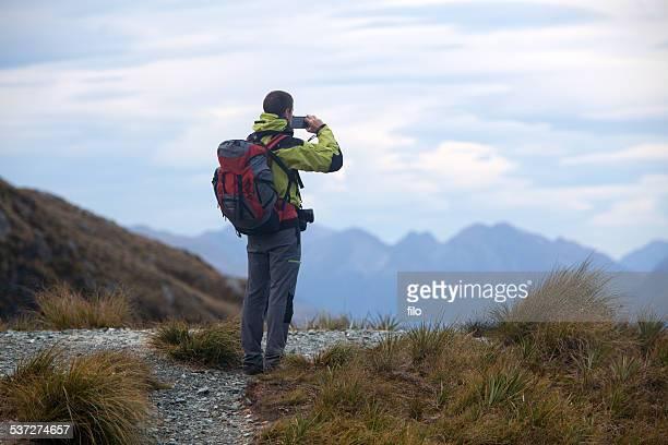 New Zealand Hiker Taking a Photograph