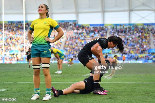 New Zealand Kelly Brazier is congratulated by team mates after scoring the winning try in the Women's Gold Medal Rugby Sevens Match between Australia...