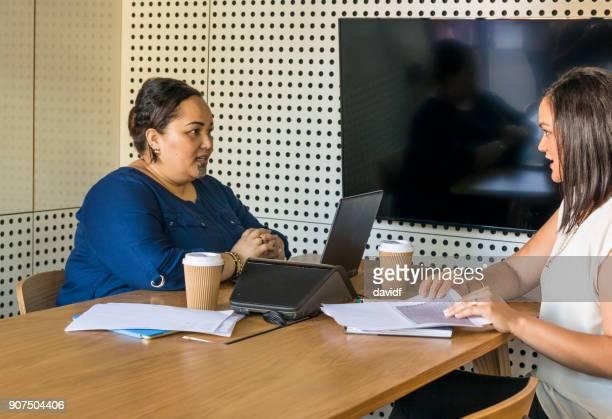 New Zealand Maori Business Women Meeting in an Open Plan Office