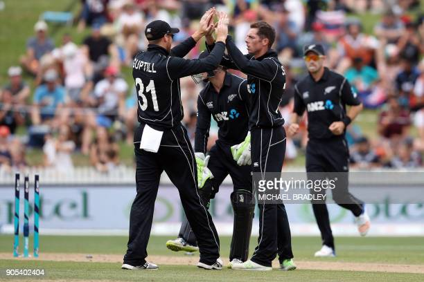 New Zealand Martin Guptill and Mitchell Santner celebrate the wicket of Pakistan's Fakhar Zaman during the fourth oneday international cricket match...