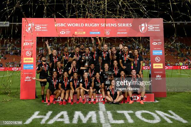 New Zealand men and women players celebrate after winning their respective Cup Finals during the 2020 HSBC Sevens at FMG Stadium Waikato on January...