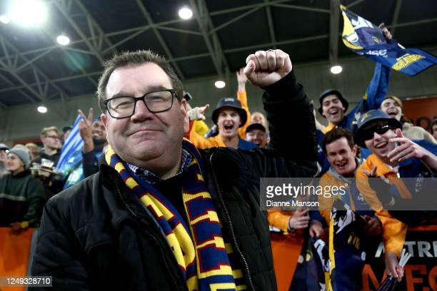 New Zealand Minister of Finance Grant Robertson shows his support during the round 1 Super Rugby Aotearoa match between the Highlanders and Chiefs at...