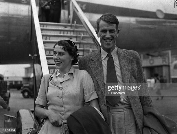 New Zealand mountain climber Sir Edmund Hillary arriving at London Airport with his wife Louise