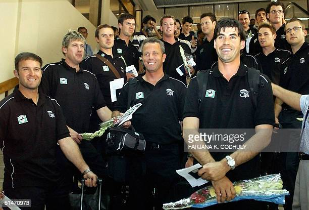 New Zealand national cricket team players pose for photographers after arriving at Zia Ineternational airport in Dhaka 12 October 2004 The New...