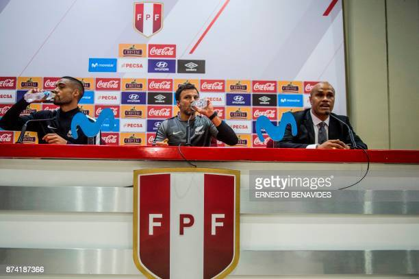 New Zealand national soccer team coach Anthony Hudson and footballer Winston Reid drink water before a press conference in Lima on November 14 2017...