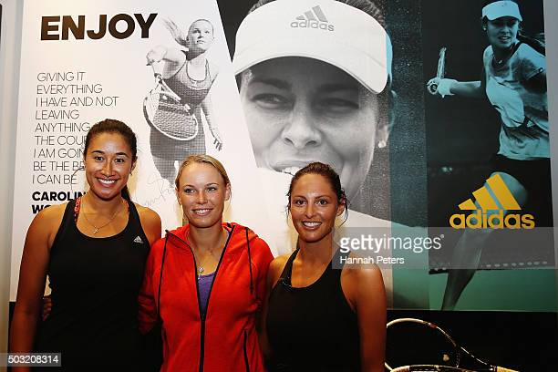 New Zealand netball player Maria Tutaia Caroline Wozniacki and TV presenter Makere Bradnam pose for a photo after taking part in an exhibition tennis...