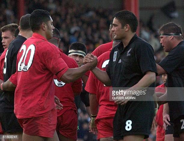 New Zealand No8 and captain Taine Randell shakes hands with Tonga flanker Mat Te Pou at the end of the firstround Rugby World Cup match between New...