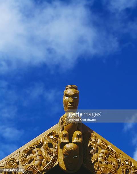 New Zealand, North Island, Rotorua, figure carved on roof