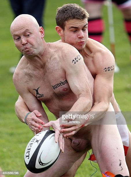 A New Zealand Nude Black looks to offload in a England tackle during the Naked Rugby match between New Zealand and England at University Oval on June...