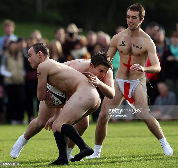 A New Zealand Nude Blacks player is tackled by an England player during the Naked Rugby match between New Zealand and England at University Oval on...