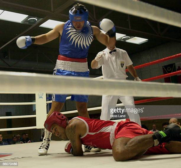 New Zealand Olympic boxer Garth Da Silva watches his opponent fall to the canvas in the first of two knockdowns in his 91kg bout against Fijian Paula...