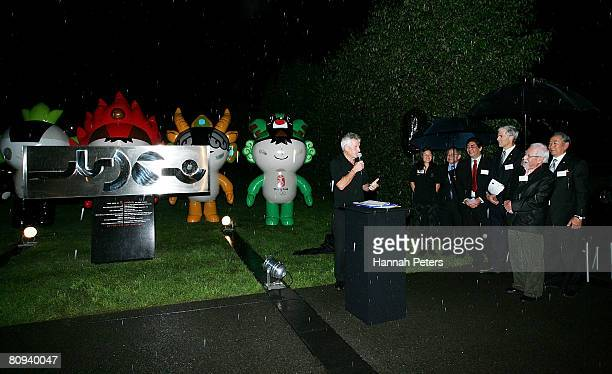 New Zealand Olympic Committee Chef de Mission Dave Currie presents the sculpture from the Chinese community to the New Zealand Olympic Team after the...