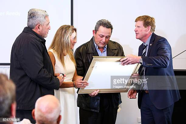 New Zealand Olympic Committee President Mike Stanley presents the NZ Olympic Order Certificate to family members of Amster Reedy during the NZOC...