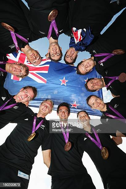 New Zealand Olympic medalists pose with their medals at the Team New Zealand Medalist Photo Call at Westfield Stratford City on August 12 2012 in...