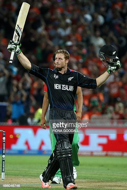 New Zealand opening batsman Martin Guptill reaches a century during the Pool A 2015 Cricket World Cup match between New Zealand and Bangladesh at...