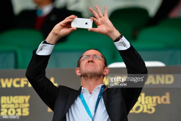New Zealand opposition leader Andrew Little takes a picture before the start of the final match of the 2015 Rugby World Cup between New Zealand and...