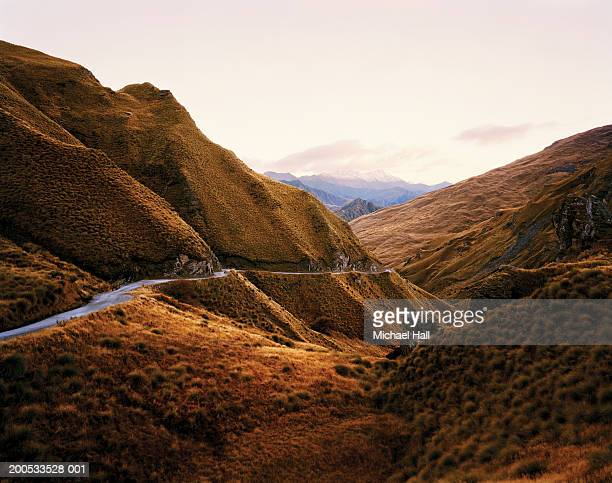 new zealand, otago, skippers canyon, road in mountainous landscape - otago region stock pictures, royalty-free photos & images