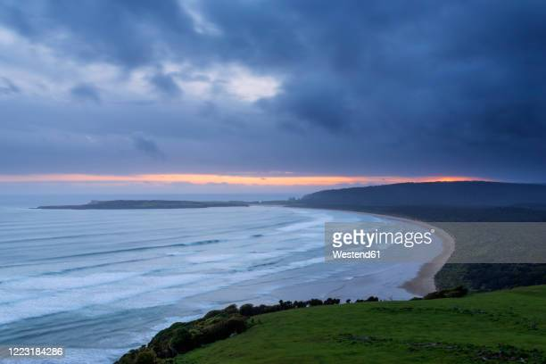new zealand, otago, tautuku beach seen from florence hill lookout at dramatic dusk - pacific ocean stock pictures, royalty-free photos & images