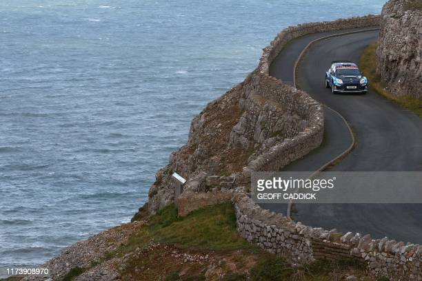 TOPSHOT New Zealand pilot Hayden Paddon and co pilot John Kennard drive their Ford Fiesta R5 MKII as they pass through the cancelled Great Orme stage...