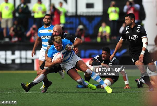 New Zealand player DJ Forbes tackles Argentina player Fernando Luna during their sevens rugby match during the HSBC USA Sevens rugby tournament on...