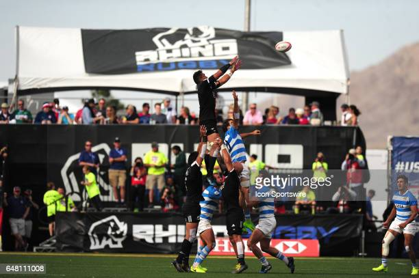 New Zealand player Iopu IopuAso goes up for the ball against Argentina player Felipe del Mestre in a lineout during their sevens rugby match during...