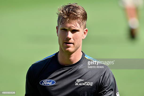 New Zealand player James Neesham walks back to the dressing room during a training session at the Gabba in Brisbane on November 4 ahead of the first...