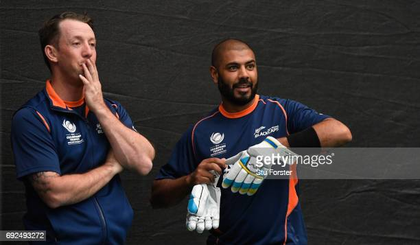 New Zealand player Jeetan Patel chats with Luke Ronchi during nets at the Swalec Stadium ahead of the ICC Champions Trophy match between England and...