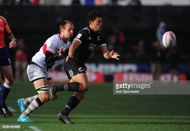 New Zealand player Tone Ng Shiu right passes in front of United States player Ben Pinkelman during their sevens rugby match at the HSBC USA Sevens...