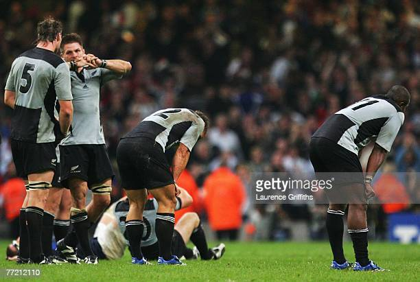 New Zealand players are dejected followign defeat in the Quarter Final of the Rugby World Cup 2007 match between New Zealand and France at the...