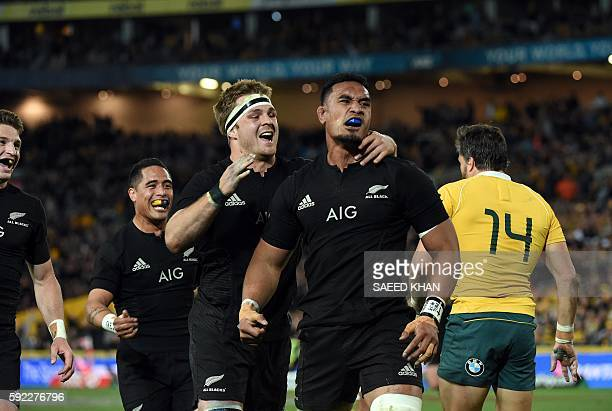 New Zealand players celebrate a successful try against Australia during their Bledisloe Cup Rugby Championship match in Sydney on August 20 2016 /...
