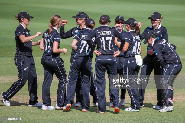 New Zealand players celebrate after getting out Alyssa Healy of the Australia during game one in the women's One Day International Series between...