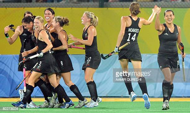 New Zealand players celebrate after scoring a goal against Germany during their women's field hockey match during the 2008 Beijing Olympics at the...