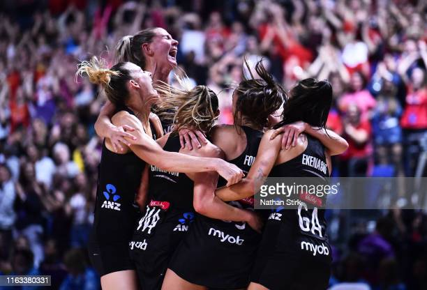 New Zealand players celebrate after winning the Vitality World Cup after the Vitality Netball World Cup Final match between Australia and New Zealand...