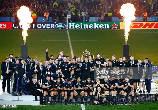 New Zealand players celebrate as Richie McCaw of New Zealand lifts the Webb Ellis Cup during the 2015 Rugby World Cup Final match between New Zealand...