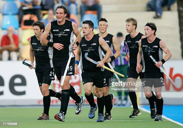 New Zealand players celebrate scoring the first goal during the World Cup Pool A match between Argentina and New Zealand at the Warsteiner Hockey...