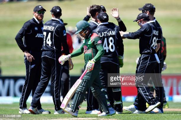 New Zealand players celebrate the dismissal of Bangladesh's Mushfiqur Rahim during the first oneday international cricket match between New Zealand...