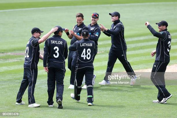 New Zealand players celebrate the dismissal of Mohammad Hafeez of Pakistan during the third game of the One Day International Series between New...