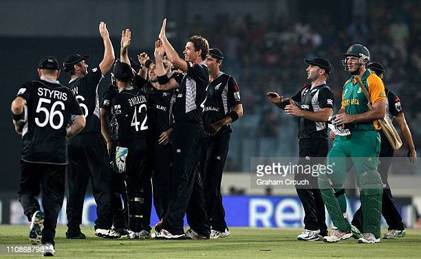 New Zealand players celebrate the wicket of Graeme Smith of South Africa during 2011 ICC World Cup QuarterFinal match between New Zealand and South...