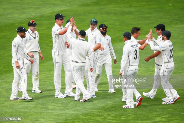New Zealand players celebrate the wicket of Mayank Agarwal of India during day one of the First Test match between New Zealand and India at Basin...