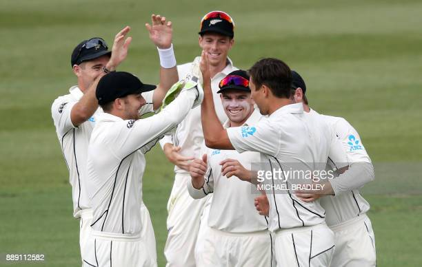New Zealand players celebrate the wicket of Shimron Hetmyer of the West Indies during day two of the second Test cricket match between New Zealand...