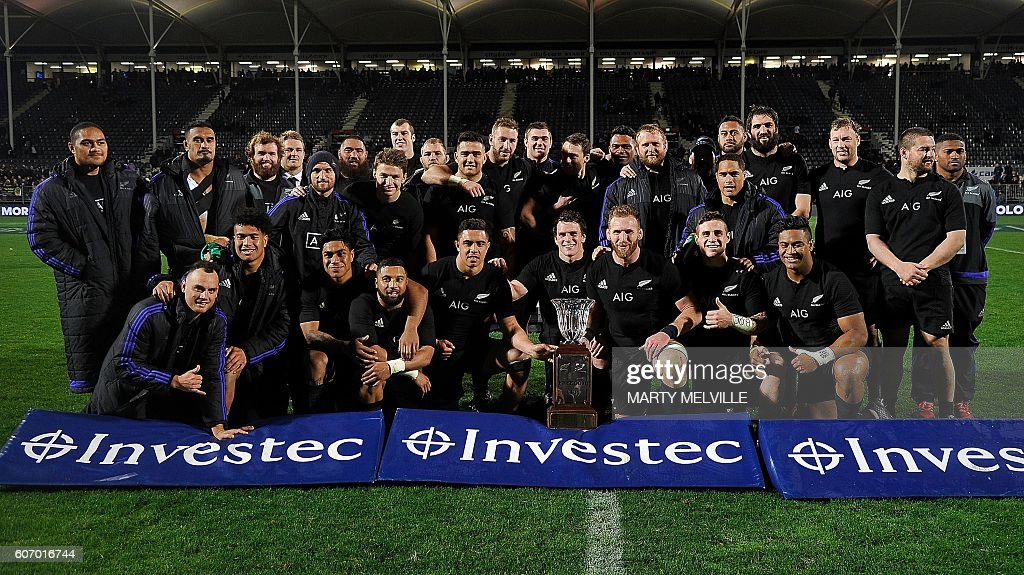 New Zealand players celebrate winning the Freedom Cup after their win over South Africa during the rugby Test match between New Zealand and South Africa at AMI Stadium in Christchurch on September 17, 2016. / AFP / Marty Melville