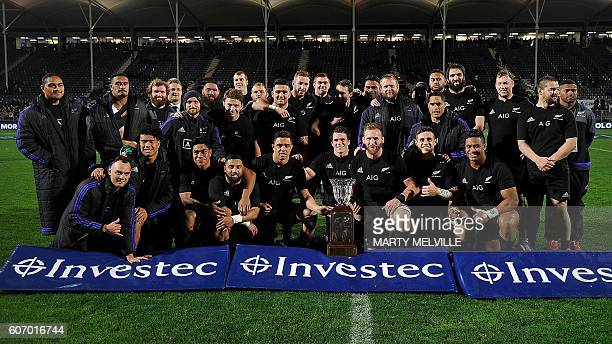 New Zealand players celebrate winning the Freedom Cup after their win over South Africa during the rugby Test match between New Zealand and South...